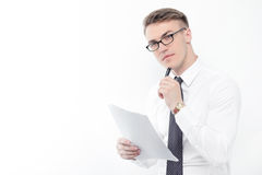 Businessman holding papers and pen Royalty Free Stock Photos