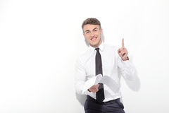 Businessman holding papers and pointing up Stock Photo