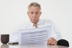Businessman Holding Paperwork Royalty Free Stock Photos