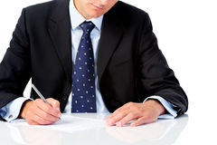 Businessman holding a pen Stock Image
