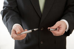 Businessman holding pen Stock Photo