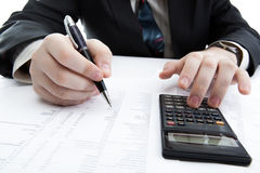 Businessman holding a pen and counts the budget Royalty Free Stock Photos