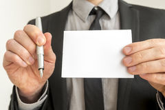 Businessman Holding Pen and Empty White Paper Royalty Free Stock Photos