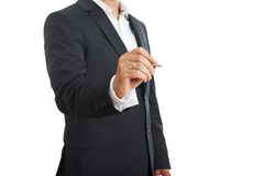 Businessman holding pen Stock Images