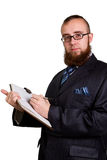 Businessman holding a pen Stock Photography