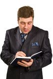 Businessman holding a pen Royalty Free Stock Image