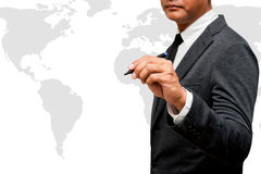 Businessman holding pen with world map. Businessman holding pen with grey world map Stock Photography