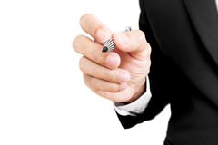 Businessman holding pen in writing position to screen, selective focus, isolated on white background Stock Image