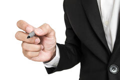 Businessman holding pen in writing position to screen, selective focus, isolated on white background Stock Photography