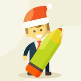 Businessman holding a pencil and Christmas hat Stock Photography