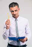 Businessman holding pencil and clipboard Royalty Free Stock Photos