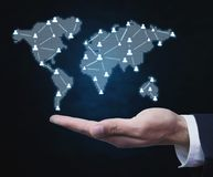 Businessman holding people symbols with world map. Global busin. Ess communication concept Royalty Free Stock Images