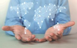 Businessman holding people symbols with world map. Global busin. Ess communication concept royalty free stock photography
