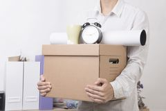 Businessman holding personal items box ready moving leaving. Company. concept layoffs Royalty Free Stock Photos