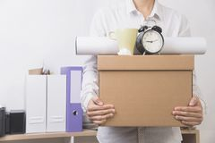 Businessman holding personal items box ready moving leaving. Company. concept layoffs Royalty Free Stock Image