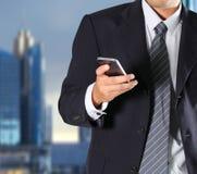 Businessman holding the phone Stock Photos