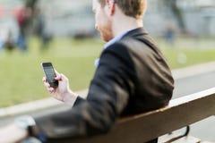 Businessman holding phone Royalty Free Stock Image