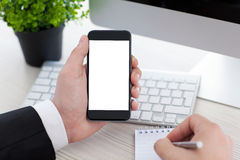 Businessman holding phone with isolated screen and writing in no Royalty Free Stock Photos