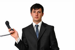 Businessman holding a phone receiver. Closeup portrait of casual businessman holding phone receiver. Isolated on white background Stock Image