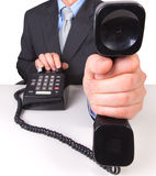 Businessman holding  phone receiver Royalty Free Stock Photography