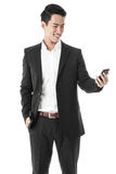 Businessman holding a phone Stock Photography