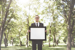 Businessman Holding Picture Frame Copy Space Concept Royalty Free Stock Photography