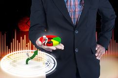 Businessman holding a pie chart Stock Photos