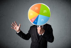 Businessman holding a pie chart Stock Image