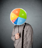 Businessman holding a pie chart Royalty Free Stock Photos
