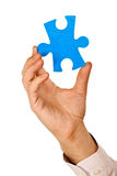 Businessman holding a piece of puzzle Royalty Free Stock Images