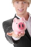 Businessman holding piggy bank Stock Images