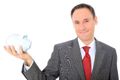 Businessman holding piggy bank Stock Photo