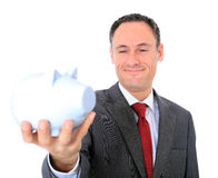 Businessman holding piggy bank Royalty Free Stock Image