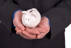 Businessman holding a Piggy bank Royalty Free Stock Photography