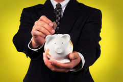 Businessman Holding Piggy Bank Stock Image