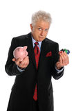 Businessman Holding Piggy Bank and Chips Stock Images