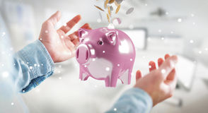 Businessman holding piggy bank with flying coins going inside 3D. Businessman on blurred background holding piggy bank with flying coins going inside 3D Royalty Free Stock Photography