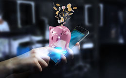 Businessman holding piggy bank with flying coins going inside 3D Royalty Free Stock Images