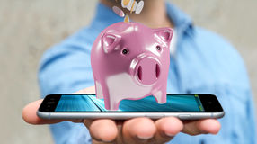 Businessman holding piggy bank with flying coins going inside 3D. Businessman on blurred background holding piggy bank with flying coins going inside 3D Stock Images