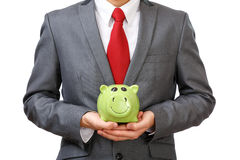 Businessman holding piggy bank Royalty Free Stock Photo