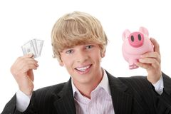 Businessman holding piggy bank and money Stock Photos