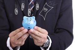 Businessman holding  Piggy bank officer put money inside Royalty Free Stock Image