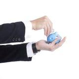 Businessman holding Piggy bank officer Stock Photography