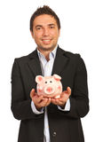 Businessman holding piggybank Royalty Free Stock Photography