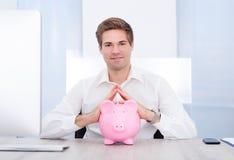 Businessman Holding Piggybank Stock Images