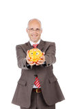 Businessman Holding Piggybank Stock Images