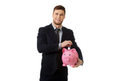 Businessman holding a piggybank. Royalty Free Stock Photo