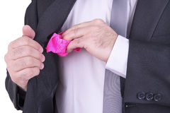 Businessman holding a pink panties. Royalty Free Stock Image