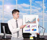 Businessman holding placard with charts Royalty Free Stock Photo