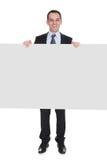 Businessman holding placard Royalty Free Stock Photos